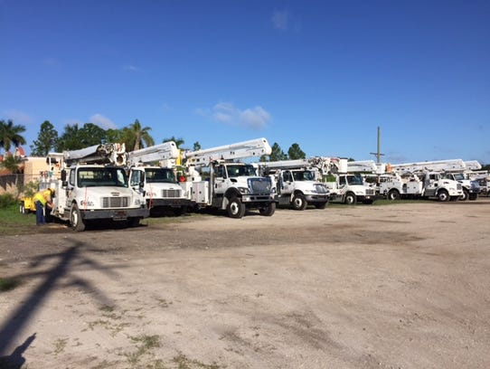 Bucket trucks from Utility Line Construction Services are lined up along 3805 Dr. Martin Luther King Jr. Boulevard in late August as part of an FPL project.