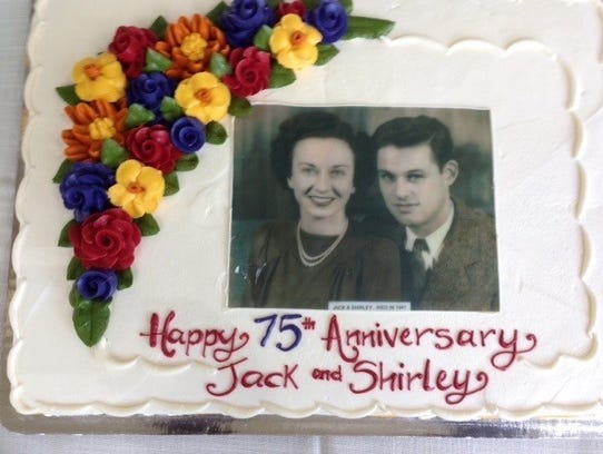 The cake was adorned with a photo of the happy couple.