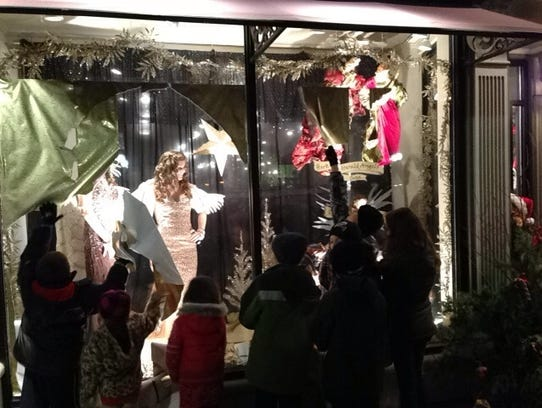 Youngsters tear off the paper covering the window at