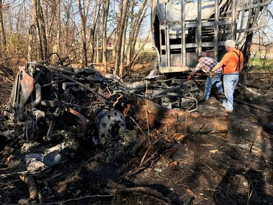 The burned wreckage of a semi truck after a crash Friday