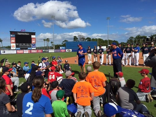 Kids listen to instructors during a St. Lucie Mets youth baseball clinic.