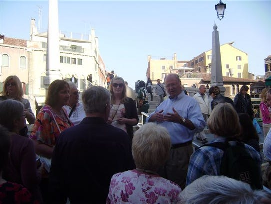 Greg Kuns of Fremont leads one of his tour groups on
