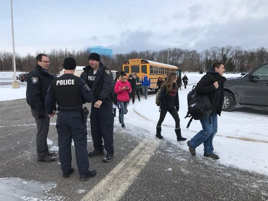 Students are evacuated by bus from Lakeview High School.