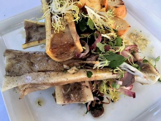 The roasted bone marrow appetizer, which includes roast