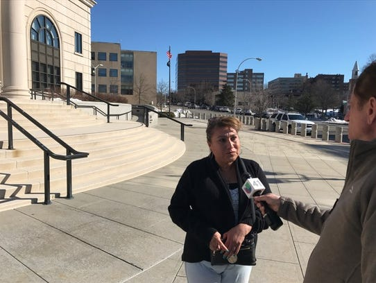 Celia Luna speaks outside the federal courthouse in