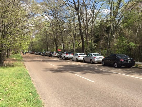 Parked cars along North Parkway next to the zoo