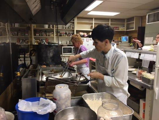 Susan McFrederick mans the deep-fryer at the Mifflin