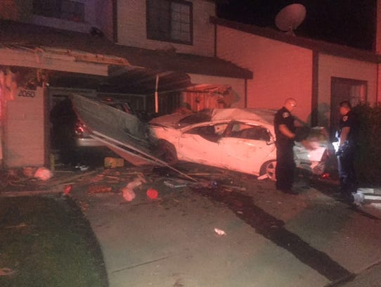 Suspected DUI driver in jail after crashing into home.