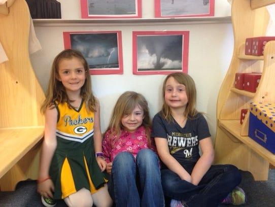 "Lilyana, Quinn and Ashlee huddle ""under the rainbow"""