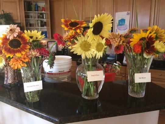 Randy Smith and Linda Raices prepare bouquets of flowers