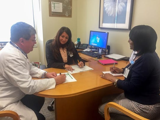 Jennifer Gales, center, is chief nursing officer at