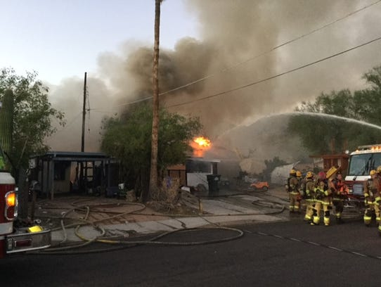 Fire crews battle a north Phoenix blaze on Aug. 9,