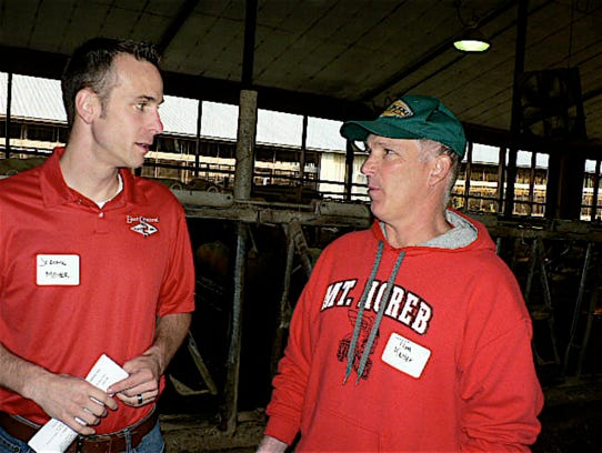 Jerome Meyer, East Central Breeders Manager (left)