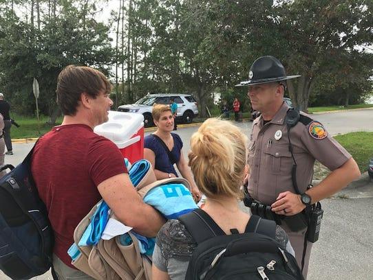 Florida Highway Patrol trooper Michael Lipari speaks