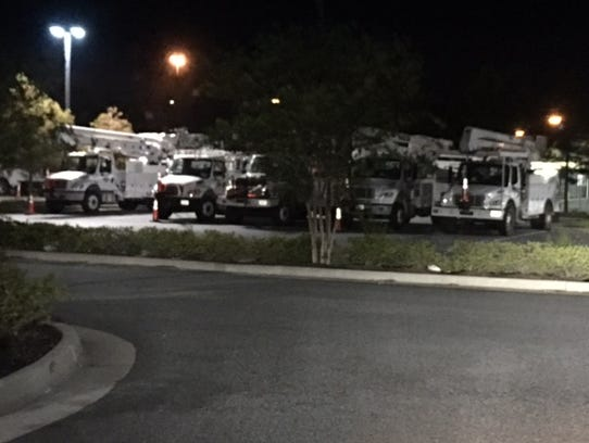 A grouping of 50 utility trucks greeted the Melendez