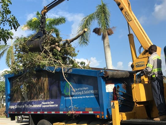 Julio Louis works the claw on a Fort Myers Public Works