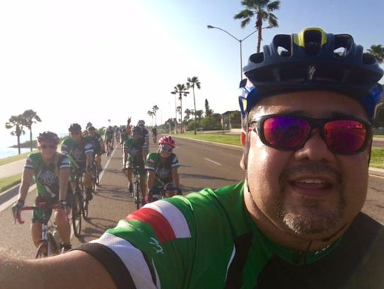 Gerardo Gomez leads a group of cyclists during the