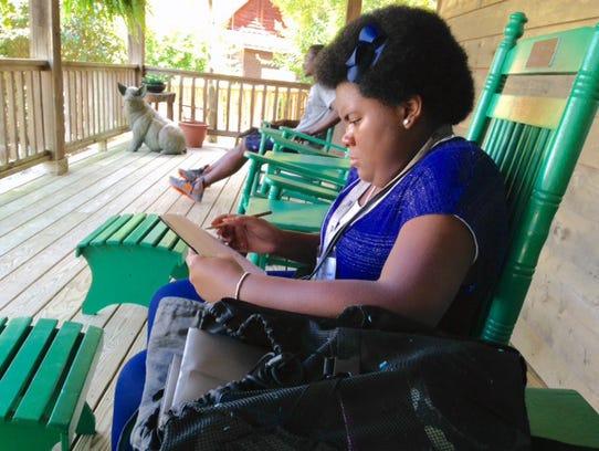 Slywenda Geeston jots notes after leaving a workshop