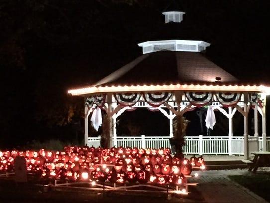 Lighted pumpkins grace the gazebo in Greendale Village.