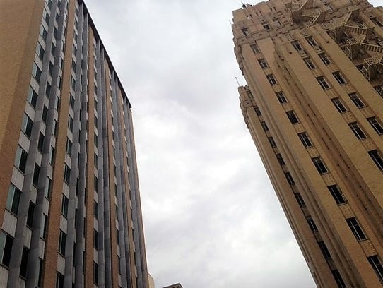 The Blue Flame building, left, and the Bassett Tower,