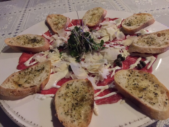 Merelli's Italian Cuisine serves an appetizer of carpaccio.
