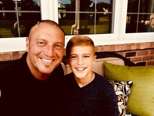 Tim Rushlow spends time at home with his son, River,
