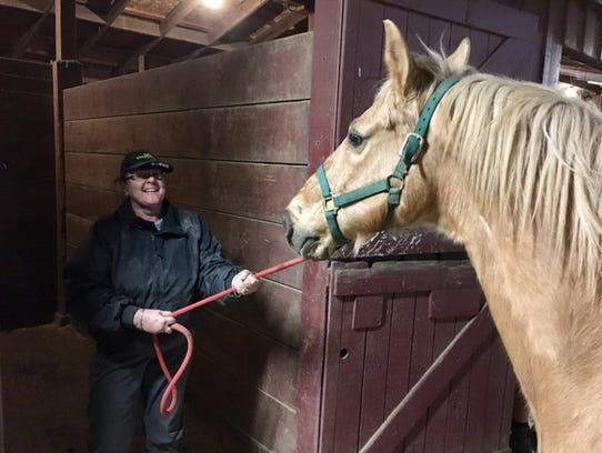 Ash Spann took her horse Kody to the fairgrounds Monday