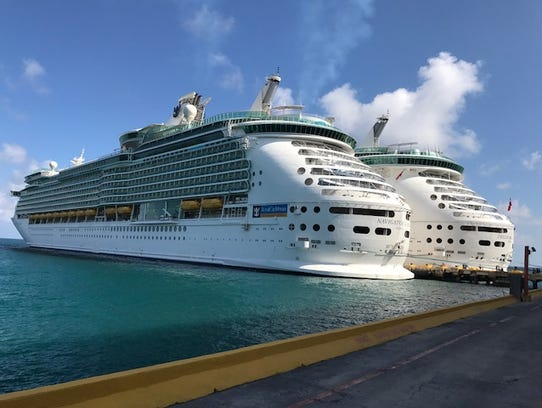The Freedom of the Seas, right, and the the Royal Caribbean boat the Navigator of the Seas, docked next to each other in Mexico, Dec. 20, 2017—one day after 12 people died, many of whom were cruise-ship passengers, while riding in a tour bus in Mexico.