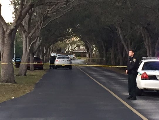 Crime scene tape and Lee County Sheriff's Office deputies