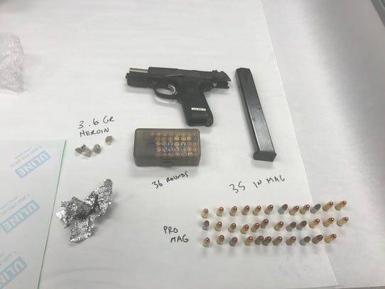 A firearm, high capacity magazine, ammunition and heroin