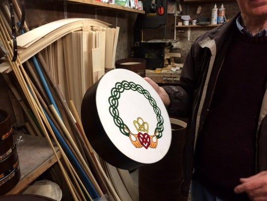 Michael Vignoles holds a bodhran.