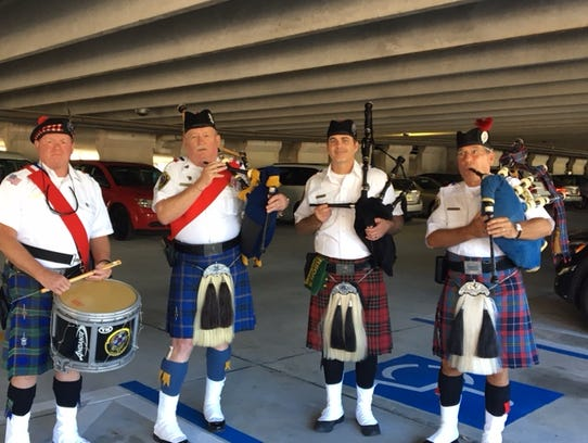 Bag pipers warm up in a parking garage before the Grand