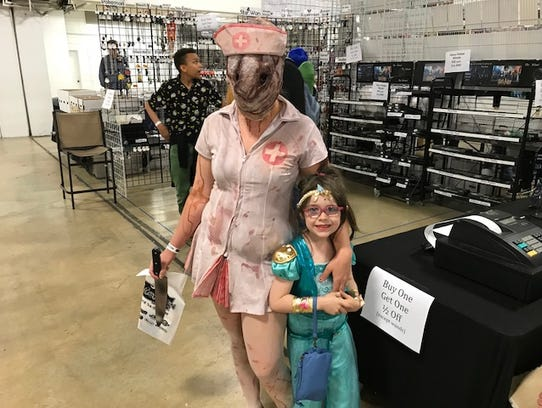 The South Carolina Comicon 2018 drew thousands of fans, many of whom dressed up as their favorite characters. Lydia and Leah Owens shared the experience together.