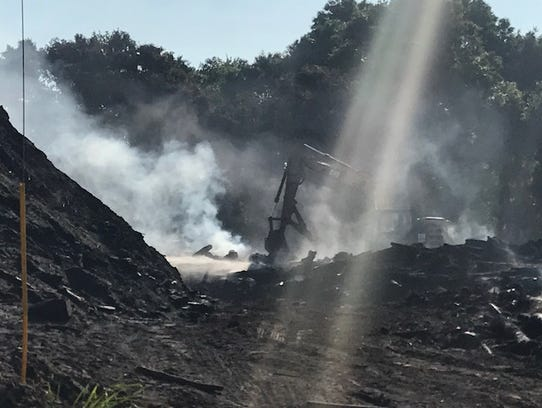 Smoke still drifts from a fire at MW Horticulture Recycling