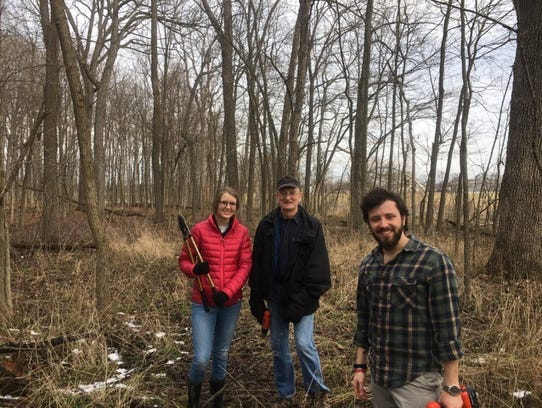 Volunteers work at Red-tail Land Conservancy's sites