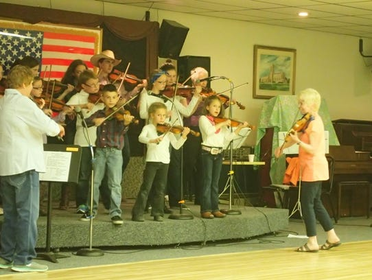 The Junior Fiddlers perform Sunday at a Barn Dance