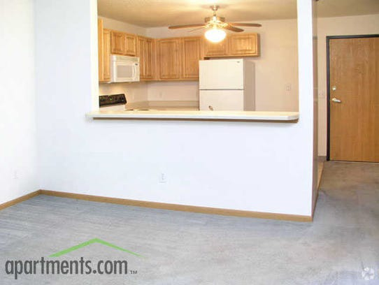 A living room and kitchen at the Parkside East Apartments,