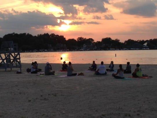 Yoga classes on the beach help Beachwood spring to