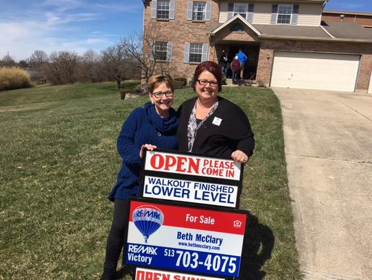 Realtors Beth McClary, left, and Donna Deaton of RE/MAX Victory in Liberty Township outside an open house in West Chester, one of the hottest markets for home sales in the region.