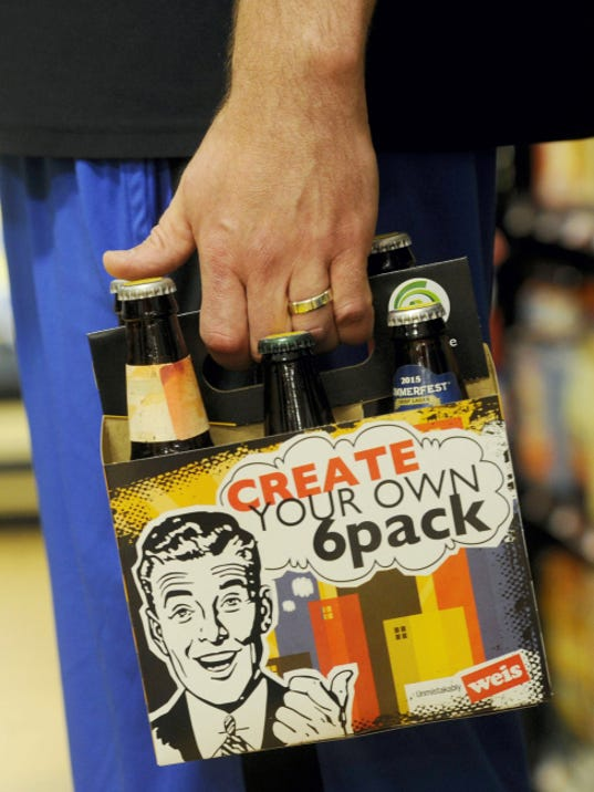 Customers have the option to mix and match into a six pack at the Beer Cafe in the West Manchester Township Weis Markets on Friday, June 19, 2015.   Jason Plotkin - Daily Record/Sunday News