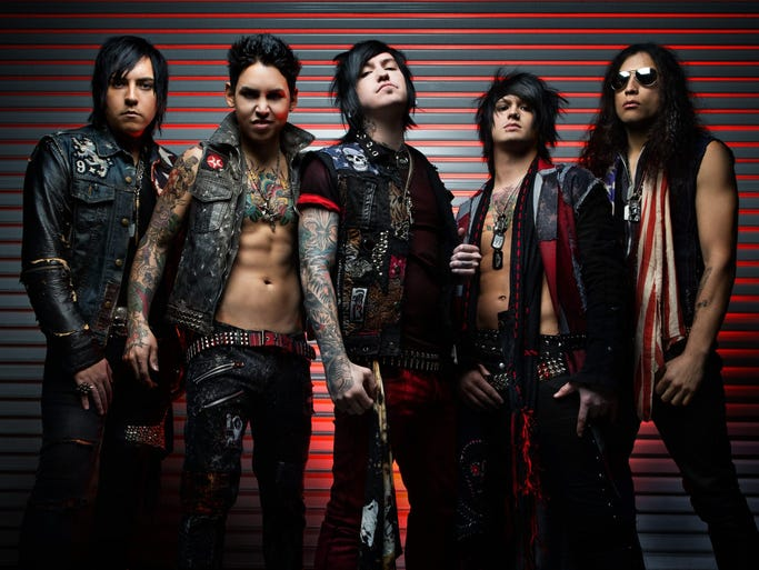 """ESCAPE THE FATE -- Call them the result of the musical theory of relativity — emo=MC5 — if you will. The dry heat of Nevada inspires many bands. Along with the climate, Escape The Fate are fueled by the works of Korn, Dio, Led Zeppelin, Fall Out Boy, Queen and Danzig. ETF also had the moxie to address the scourge of youth known as bullying in their video for """"Ungrateful"""" in 2013. Dogged by changes in personnel, they soldier on."""