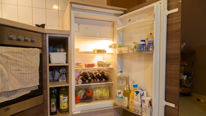 Take a tour of a modern fridge, and learn how expensive it is to stock a refrigerator for a family of four for a week.