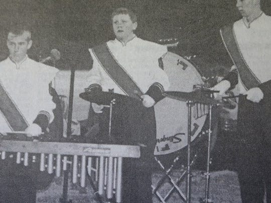 Three members of the Union County High School Marching Band are shown above during their performance on a Friday night football game in 2000.