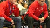 Mike Roumph, left, sits next to head coach Dax Charles during a wrestling match at Colorado State University-Pueblo.