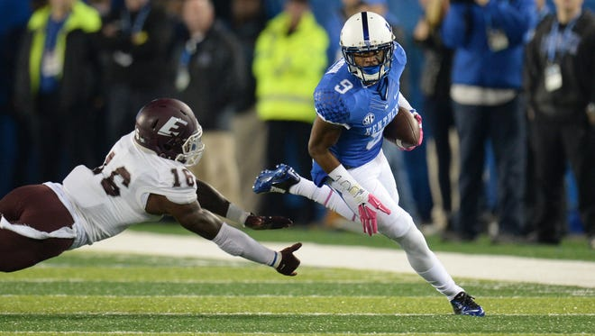 UK WR Garrett Johnson runs after the catch during the first half of the University of Kentucky - Eastern Kentucky University football game at Commonwealth Stadium in Lexington, Ky., on Saturday, October 3, 2015.
