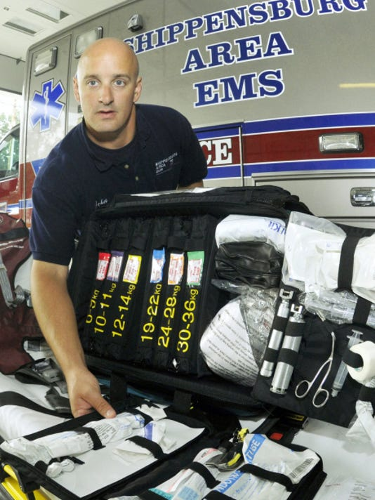 Paramedic John Rice displays the pediatric bag used on ambulance units Tuesday at Shippensburg Area Emergency Services.