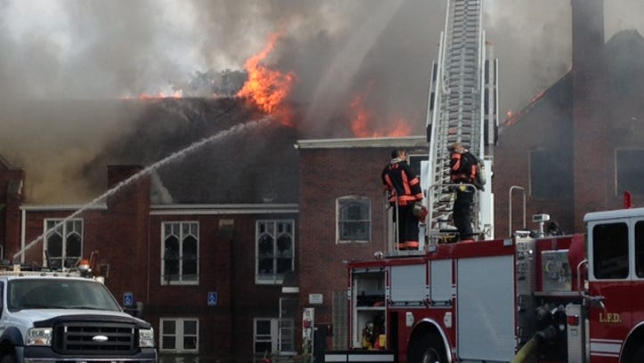Aug. 28, 2014: Flames come off the roof of the First Lutheran Church in Lorain at 6th and Washington.