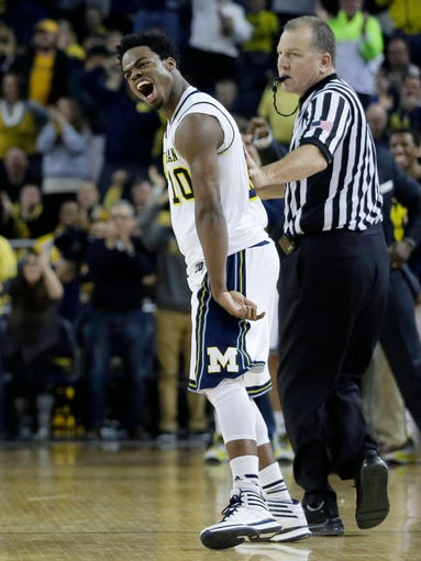 Derrick Walton Jr. yells after Michigan forced a turnover
