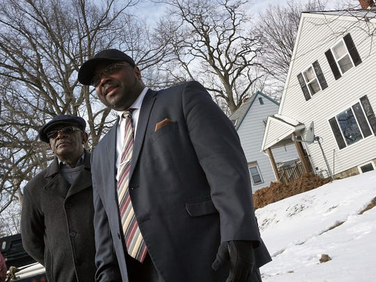 Pastor Derek Williams of Mt Calvary Baptist Church, right, and Robert Chapmon, Vice President of the Mend Mansfield Coalition, talk in front of the house that was the scene of a recent shooting Thursday afternoon.