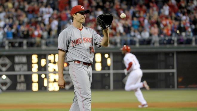 Cincinnati Reds starting pitcher Homer Bailey (34) reacts after allowing a home run to Philadelphia Phillies left fielder Domonic Brown (9) in the fourth inning.